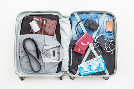 Photo pour travel traveler traveling bag top open view packing card camera packed credit wallet clothing table leaving departure concept - stock image - image libre de droit