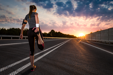 Photo for stretching run runner road jogging clothes flare sunset street fitness cross sunbeam success running sportswear - stock image - Royalty Free Image
