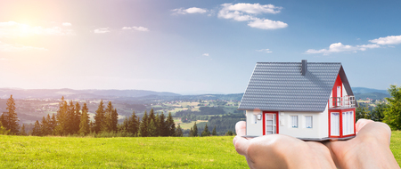 Photo pour housing house hand real home holding green grass blue sky- stock image - image libre de droit
