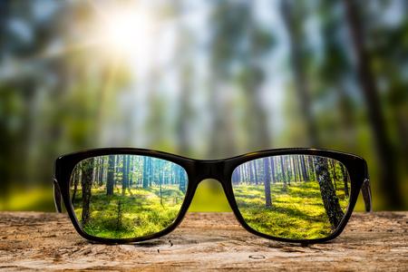 Photo pour glasses focus background wooden eye vision lens eyeglasses nature reflection look looking through see clear sight concept transparent sunrise prescription sunset vintage sunny sun retro - stock image - image libre de droit
