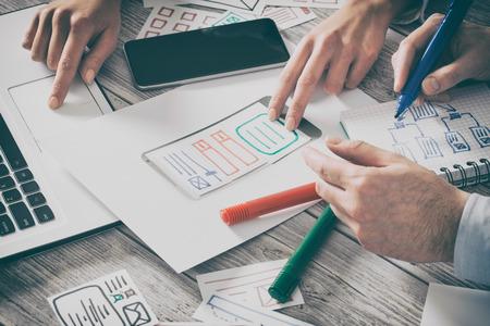 Photo pour ux designer designing designers web brand phone smartphone layout geek business prototype internet goals sketch plan write idea success solution concept - stock image - image libre de droit