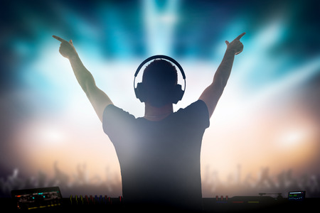 Photo for Charismatic disc jockey. Club, disco DJ playing and mixing music for crowd people. - Royalty Free Image