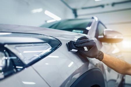 Foto de Car detailing - Man applies nano protective coating to the car. Selective focus. - Imagen libre de derechos