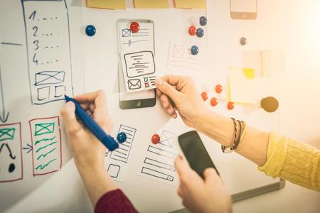 Designer woman drawing website ux app development. User experience concept.