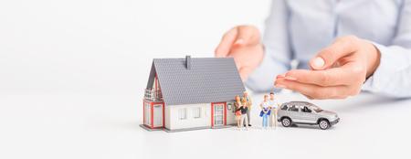 Foto de Insurance house, car and family health live concept. The insurance agent presents the toys that symbolize the coverage. - Imagen libre de derechos