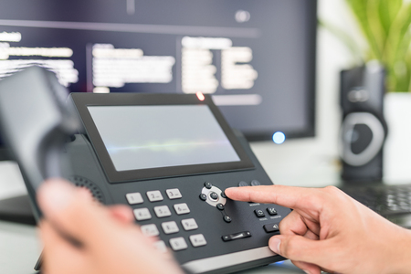 Foto de Communication support, call center and customer service help desk. Using a telephone keypad.  - Imagen libre de derechos