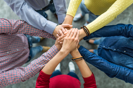 Photo for Close up top view of young business people putting their hands together. Stack of hands. Unity and teamwork concept. - Royalty Free Image
