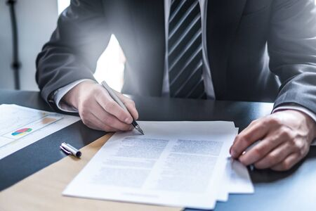 Photo pour Business man signing contract document on office desk, making a deal. - image libre de droit