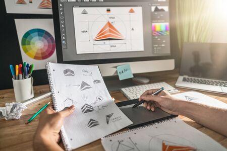 Photo pour Graphic designer drawing sketches logo design. The concept of a new brand. Professional creative occupation with idea. - image libre de droit