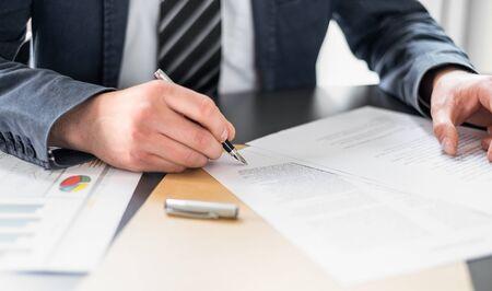 Photo pour Business man signing contract document on office desk, making a deal. - image libre de droit