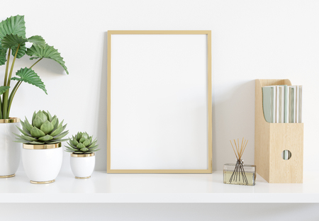 Photo pour Golden frame leaning on white shelve in bright interior with plants and books mockup 3D rendering - image libre de droit