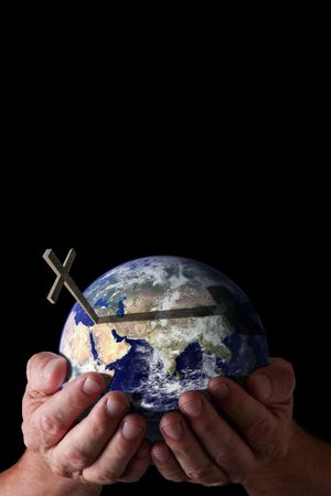 Religious concept.  God's hands holding world with cross on isolated black background. Earth image courtesy of NASA.