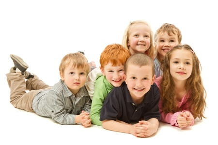 Group of six children laying down on other kdis on floor together  Isolated on white
