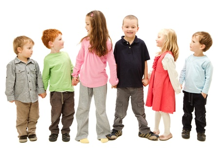 Photo pour Group of six happy children standing and holding other kids hands  Isolated on white  - image libre de droit