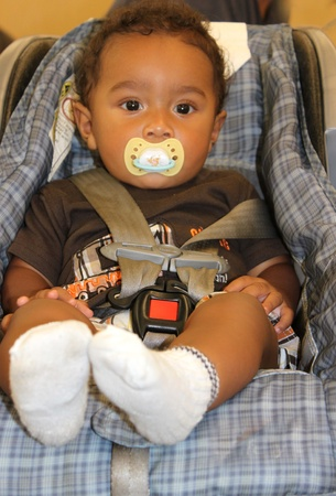 Photo pour African american baby in carseat - image libre de droit