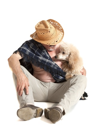 Man in a hat sitting with a poodle on white background