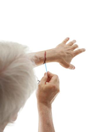 male hand applying iodine isolated on white