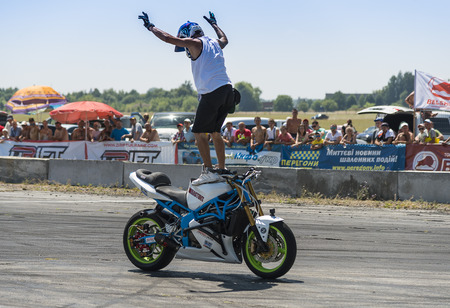 Vinnytsia,Ukraine-July 25, 2015: Unknown stunt biker entertain the audience before the start of the championship of drifting   on July 25,2015 in Vinnytsia, Ukraine.