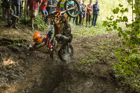 Lviv, Ukraine - 11 Septemberl 2016: The third stage of the Ukrainian championship in cross-country cycling . Unknown rider falls at overcoming the track in the woods