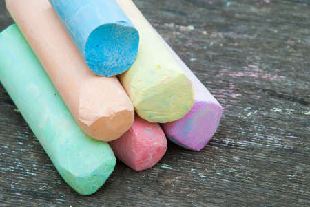 Photo for Colored chalk for drawing on a wooden background. - Royalty Free Image