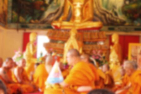 Blurred many buddhist monk in thai temple