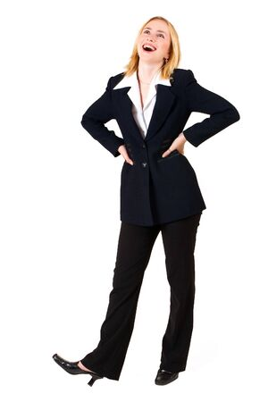 Business woman in formal black suit, looking up with hands on hips
