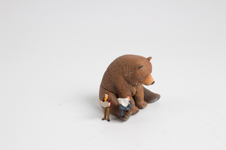 the mini figure read the newspaper with the bear