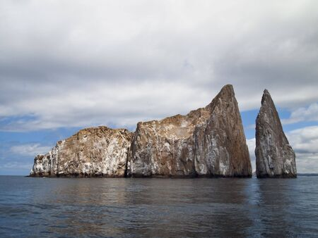 Kicker Rock, or Leon Dormido, is a desolate, barren rock off San Cristobal Island in the Galapagos that is a favored spot for snorkeling and scuba diving.