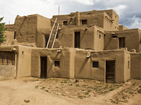 A traditional pueblo building in New Mexico. With walls formed of mud and straw, the multi-story structure is representative of native American culture.