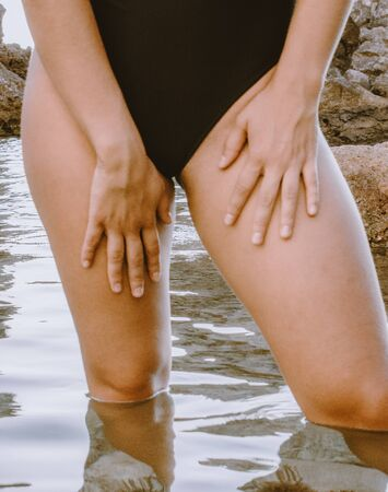 Photo pour Latin girl embarrassed for not having shaved legs or bikini. lack of laser hair removal. proud of her body fit woman concept - image libre de droit