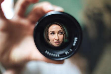Photo pour close up portrait through a lense blonde hair - image libre de droit