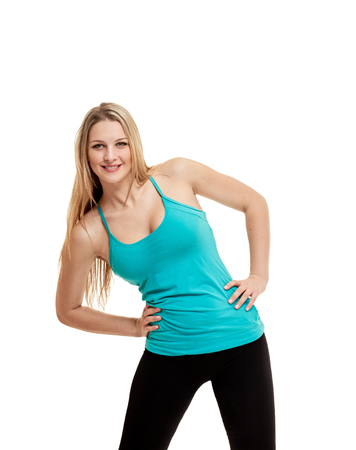 Cheerfully smiling woman doing exercise , isolated on white backgroundの写真素材
