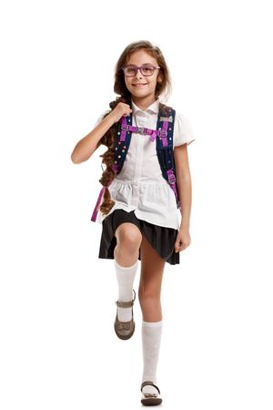 Schoolgirl with bag marching
