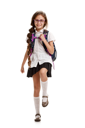 pretty Schoolgirl with bag marching