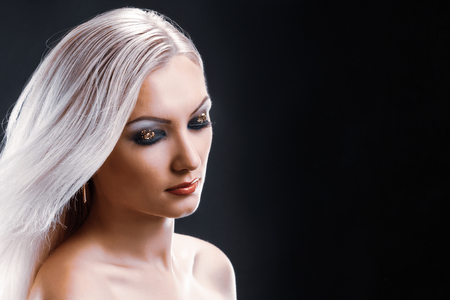 Photo for Attractive young blonde woman with bright makeup posing - Royalty Free Image