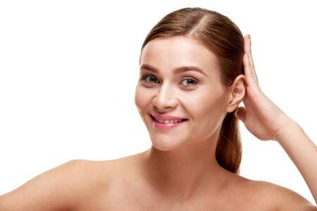 Photo pour Attractive smiling woman touching her healthy shiny hair - image libre de droit