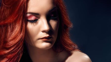 Photo pour Romantic portrait of young beautiful woman with long curly hair - image libre de droit