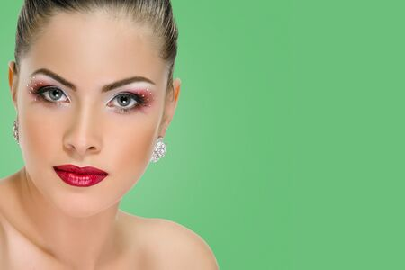 Photo for Sexy woman with red lips on background emerald shade green color - Royalty Free Image