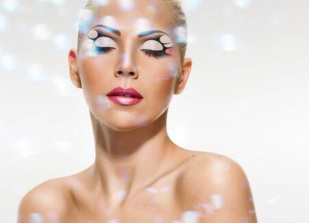 Foto de face of young woman with makeup on grey background, double multiple exposure effect,combined images - Imagen libre de derechos