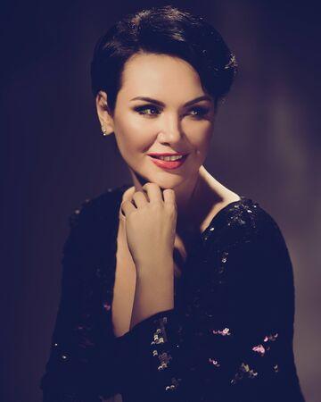 Photo pour Elegant stylish hollywood woman in expensive black dress. retro style toned image - image libre de droit