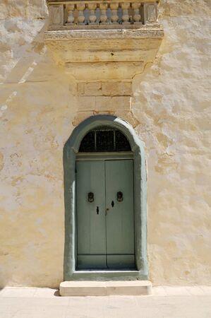 Maltese house with nice mint green door.