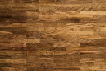 Wood texture - parquet floor made of the natural american walnut wood.