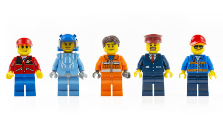 Muenster, Germany - March 8th 2015: A group of five various lego mini characters isolated on white. 