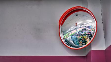 Photo pour Round Security Mirror on top of The Corner in a Convenient Store - image libre de droit