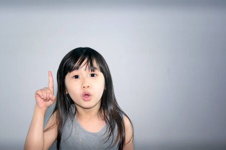 Photo pour Asian Little Girl with an Idea and Eureka Moment - image libre de droit