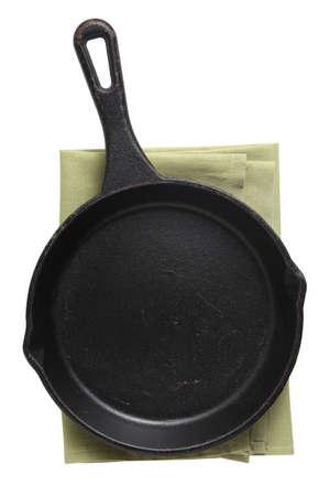 Photo pour Empty iron pan and napkin isolated on white background - image libre de droit