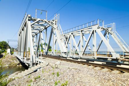 Railway bridge on the background of bright blue sky