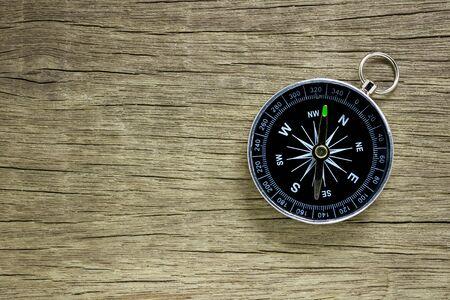 Foto de compass on old wood floor background. - Imagen libre de derechos