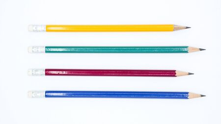 Foto de yellow, green, red and blue pencil isolated on white background - Imagen libre de derechos