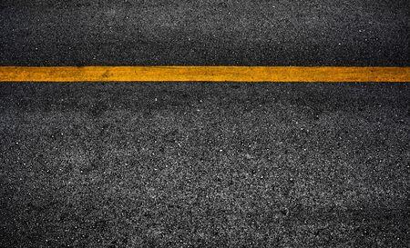 Photo pour Yellow paint line on black asphalt. space transportation background - image libre de droit
